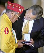 Bush fawning over embarrassed Navajo veteran.